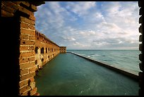 Fort Jefferson wall and moat, framed by cannon window. Dry Tortugas National Park, Florida, USA.