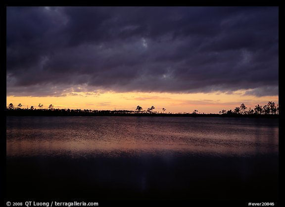 Sunset with dark clouds,  Pine Glades Lake. Everglades National Park (color)