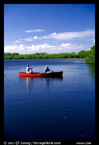 Fishing from a red canoe. Everglades National Park (color)