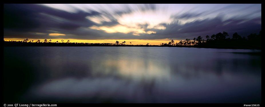 Dark clouds in motion at sunset over lake. Everglades National Park (color)
