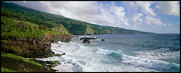Coastline with volcanic cliffs and strong surf. Haleakala National Park, Hawaii, USA.
