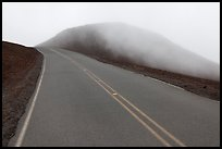 Summit road in fog, Haleakala crater. Haleakala National Park, Hawaii, USA.
