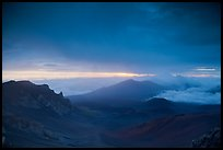 Haleakala crater and rain clouds at sunrise. Haleakala National Park, Hawaii, USA.