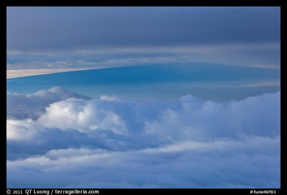 Mauna Loa between clouds, seen from Halekala summit. Haleakala National Park (color)