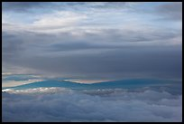 Mauna Kea and Mauna Loa between clouds. Haleakala National Park, Hawaii, USA.