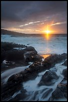 Sunrise over stormy ocean. Haleakala National Park, Hawaii, USA.