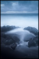 Surf, rocks, ocean and clouds, long exposure. Haleakala National Park, Hawaii, USA.