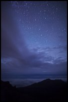 Haleakala Crater ridge and starry sky at night. Haleakala National Park, Hawaii, USA.