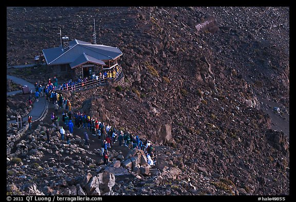 Visitor center and sunrise watchers at dawn. Haleakala National Park, Hawaii, USA.
