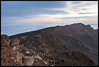 Haleakala crater with visitors gathered for sunrise. Haleakala National Park, Hawaii, USA.