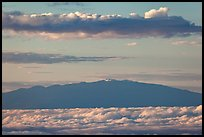 Mauna Kea and clouds at sunrise. Haleakala National Park, Hawaii, USA.