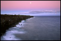 Holei Pali cliffs and moon at dusk. Hawaii Volcanoes National Park, Hawaii, USA.