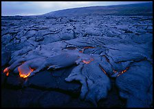 Field of lava flowing at dusk near end of Chain of Craters road. Hawaii Volcanoes National Park, Hawaii, USA. (color)