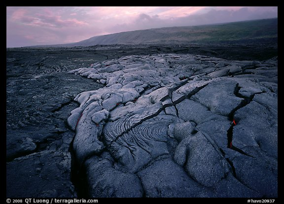 Fresh lava with cracks showing molten lava underneath. Hawaii Volcanoes National Park, Hawaii, USA.