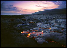 Volcanic landscape with molten lava flow and red spots at sunset. Hawaii Volcanoes National Park ( color)