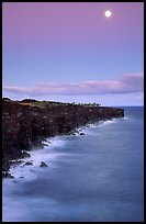 Holei Pali volcanic cliffs and moon at dusk. Hawaii Volcanoes National Park, Hawaii, USA.
