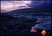 Live lava advancing at sunset. Hawaii Volcanoes National Park, Hawaii, USA. (color)
