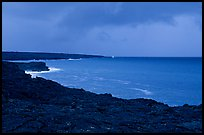 Coast covered with hardened lava and approaching storm. Hawaii Volcanoes National Park, Hawaii, USA.