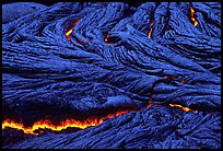 Close-up of ripples of flowing pahoehoe lava at dusk. Hawaii Volcanoes National Park, Hawaii, USA. (color)