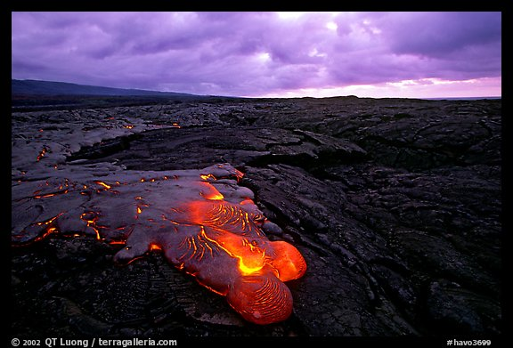 Flowing lava and rain clouds at dawn. Hawaii Volcanoes National Park (color)