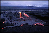 Molten lava flow at dawn on coastal plain. Hawaii Volcanoes National Park, Hawaii, USA. (color)