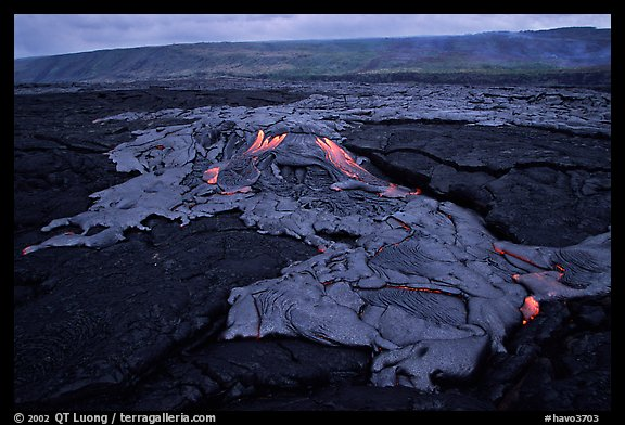 Live hot lava flows over hardened lava. Hawaii Volcanoes National Park (color)