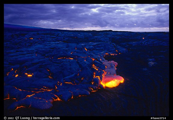 Red lava glows at dawn. Hawaii Volcanoes National Park (color)