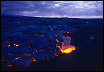 Red lava glows at dawn. Hawaii Volcanoes National Park, Hawaii, USA.