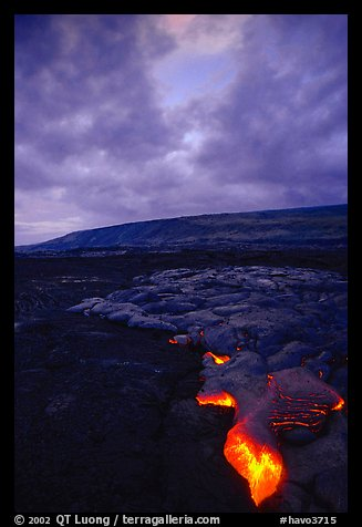 Molten Lava glows at dawn. Hawaii Volcanoes National Park (color)