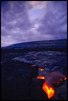 Molten Lava glows at dawn. Hawaii Volcanoes National Park, Hawaii, USA.