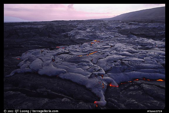 Live lava flow at sunset near the end of Chain of Craters road. Hawaii Volcanoes National Park (color)
