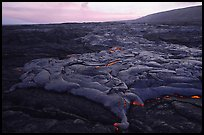 Live lava flow at sunset near the end of Chain of Craters road. Hawaii Volcanoes National Park, Hawaii, USA.