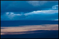 Light, shadows and clouds over Mauna Loa summit. Hawaii Volcanoes National Park, Hawaii, USA.