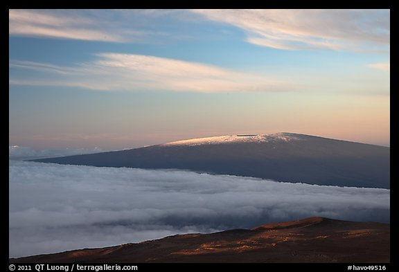 Snowy Mauna Loa above clouds at sunrise. Hawaii Volcanoes National Park (color)