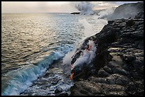 Coastline with lava entering ocean. Hawaii Volcanoes National Park, Hawaii, USA. (color)