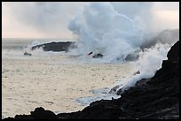 Steam rising off lava flowing into ocean. Hawaii Volcanoes National Park, Hawaii, USA. (color)