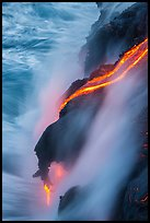 Glowing lava flow reaching the sea. Hawaii Volcanoes National Park ( color)