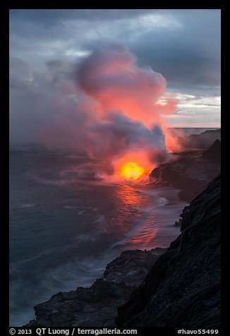 Coastline with steam illuminated by molten lava. Hawaii Volcanoes National Park (color)