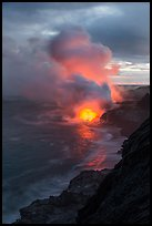 Coastline with steam illuminated by molten lava. Hawaii Volcanoes National Park, Hawaii, USA. (color)