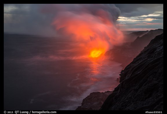 Coastline with steam lit by hot lava. Hawaii Volcanoes National Park (color)