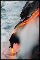 Ribbons of lava flow into the Pacific Ocean. Hawaii Volcanoes National Park, Hawaii, USA. (color)
