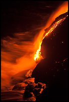 Lava flow entering Pacific Ocean at night. Hawaii Volcanoes National Park, Hawaii, USA. (color)