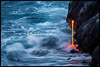 Waves and lava spigot. Hawaii Volcanoes National Park, Hawaii, USA. (color)