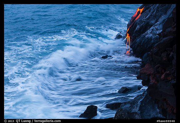 Waves and hot lava dripping from lava bench. Hawaii Volcanoes National Park (color)