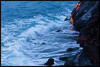 Waves and hot lava dripping from lava bench. Hawaii Volcanoes National Park, Hawaii, USA. (color)