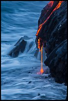 Hot lava drips into ocean waters at dawn. Hawaii Volcanoes National Park, Hawaii, USA. (color)