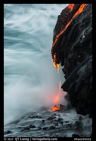 Molten lava drips into the sea. Hawaii Volcanoes National Park (color)