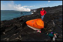 Photographer camping near lava ocean entry. Hawaii Volcanoes National Park ( color)