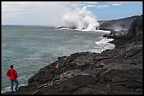 Park visitor looking, lava ocean entry plume. Hawaii Volcanoes National Park, Hawaii, USA.