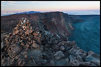 Summit cairn and crater at dusk. Hawaii Volcanoes National Park, Hawaii, USA. (color)